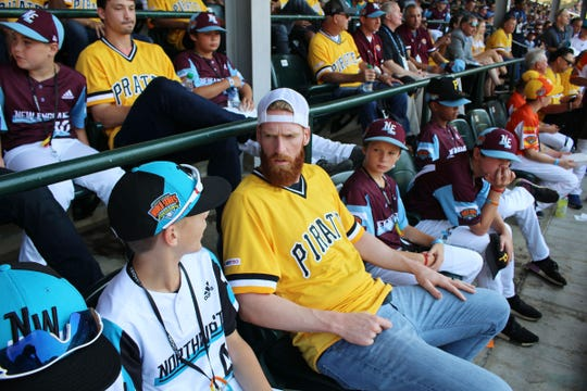 Cameron Van Kempen from the Sprague Little League all-star team sits with Colin Moran from the Pittsburgh Pirates August 18, during a Little League Baseball World Series game between Loudoun South, Va. and Coon Rapids/Andover, Minn.