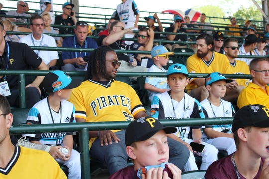 Riley Wilson, left, sits with Josh Bell of the Pittsburgh Pirates, and Sprague teammates Henry Mhoon and Thomas VanBishler discussing baseball, sweet potatoes and other subjects while watching Sunday's Little League Baseball World Series game between Loudoun South, Va. and Coon Rapids/Andover, Minn.