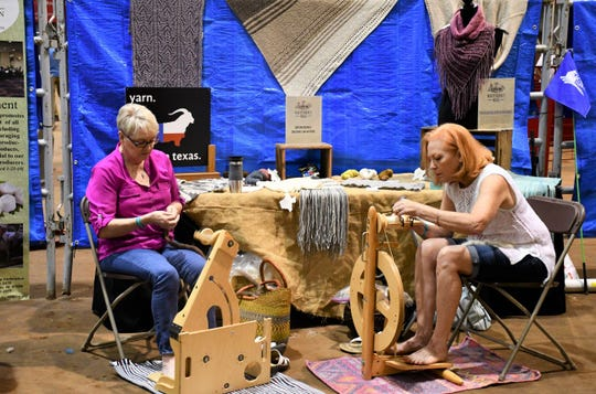 Wool booth vendors demonstrated their spinning techniques.