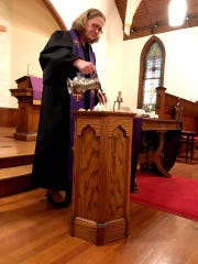 Monica Gould, pastor of Naomi Makemie Presbyterian Church and Makemie Presbyterian Church in Accomack County, takes part in the Ash Wednesday service at Naomi Makemie Church in Onancock, Virginia in 2019.