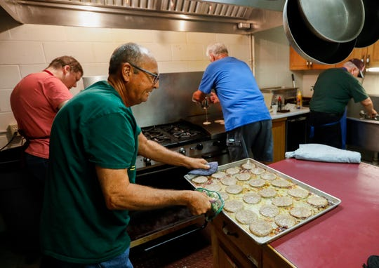 Bruce Sudduth pulls a pan of sausage out of the oven at Parkview Christian Church while preparing breakfast for Parkview High School students at the church on Tuesday, Aug. 20, 2019, in Springfield, Mo.