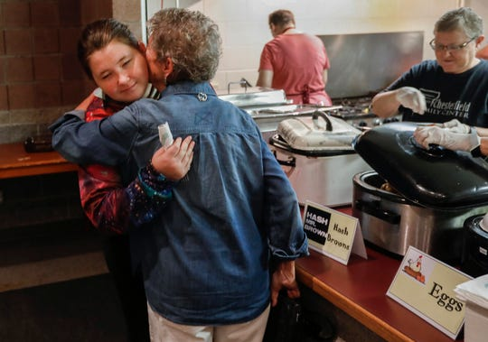 Sara Carr, right, hugs Parkview High School student Ruby Amant at Parkview Christian Church on Tuesday, Aug. 20, 2019, in Springfield, Mo.