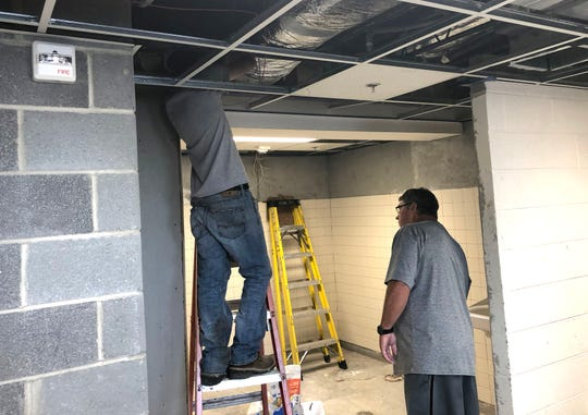 Waynesboro High School athletic director Derek McDaniel checks up on the construction progress in the locker rooms.