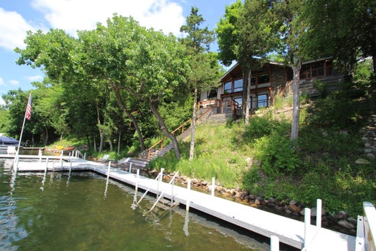 The home sits on 120 feet of lakeshore.