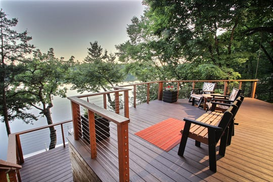 The multi-level deck is designed for optimal waterfront viewing.