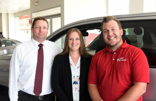 Members of the St. Cloud Toyota team Mick Henkemeyer, Abby Petrack and Nate Laudenbach pose for a photo in the dealership showroom Tuesday, Aug. 20, 2019.