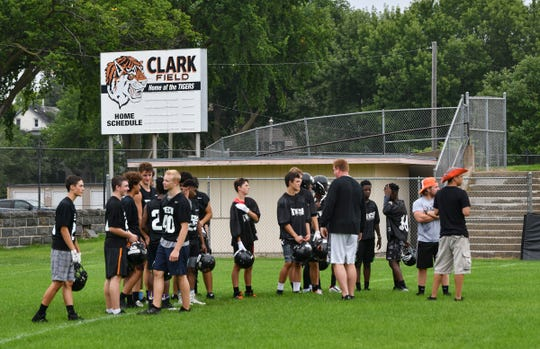 Tech players wait for instructions during football practice Monday, Aug. 12, 2019, at Clark Field in St. Cloud.