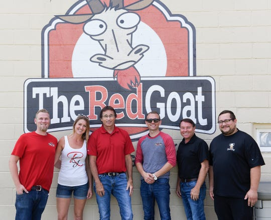 Chris Lease, Ali Lease, Mike Lease, Joshua Lease, Mark Lease and Billy Reinholdt pose for a picture at The Red Goat Friday, Aug. 16, 2019, in Watkins.