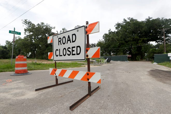 A road closure sign prevents anyone from going down Miles Street where construction is underway and the oak trees are being threatened Tuesday, Aug. 20, 2019.
