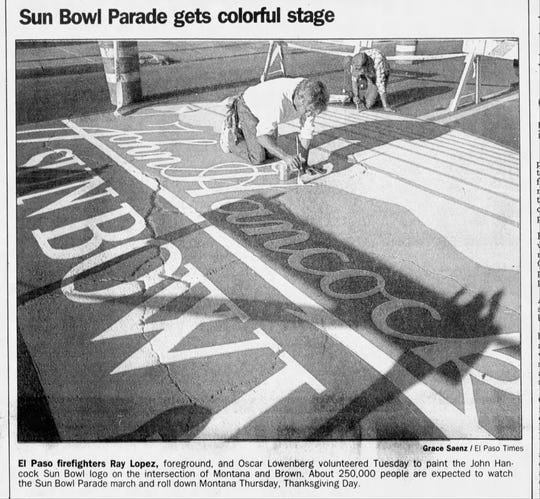 1988: El Paso firefighters Ray Lopez, foreground, and Oscar Lowenberg volunteered to paint the John Hancock Sun Bowl logo on the intersection of Montana and Brown. About 250,000 people are expected to watch the Sun Bowl Parade march and roll down Montana Thanksgiving Day.