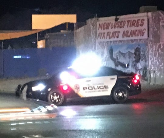 An El Paso police car blocks Tompkins Road at Dyer Street during a shooting investigating on Monday, Aug. 19, 2019.
