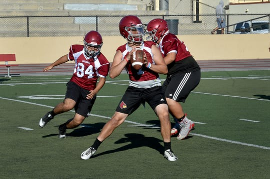 Santa Paula High quarterback Hector Zuniga prepares to throw a pass during Monday's practice. Zuniga, a junior, will be taking the reins of the offense this season.