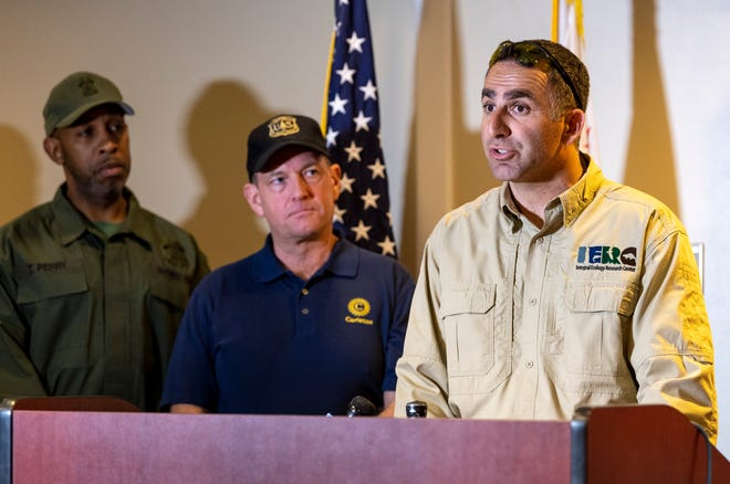 California-based Ecologist Mourad Gabriel, right, U.S. Attorney McGregor Scott, USDA Forest Service Law Enforcement & Investigations Director Tracy Perry and other law enforcement leaders spoke Tuesday, August 20, 2019 at the Fresno Air National Guard Base about recent efforts targeting marijuana grows on public lands.
