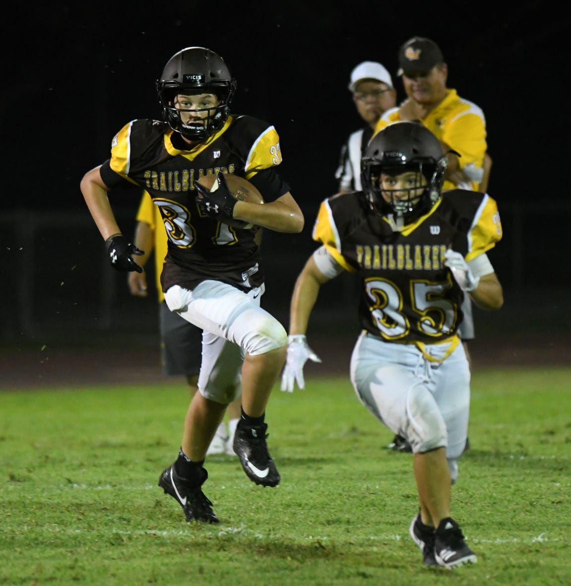 Golden West's Angel Celaya, right, runs upfield in a scrimmage against Selma on Aug. 15, 2019 at Visalia Community Stadium.