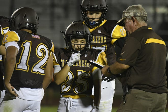 Golden West's Angel Celaya waits for the play call in a scrimmage against Selma on Aug. 15, 2019 at Visalia Community Stadium.