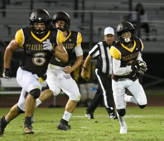 The Golden West High School football team scrimmages Selma on Aug. 15, 2019 at Visalia Community Stadium.