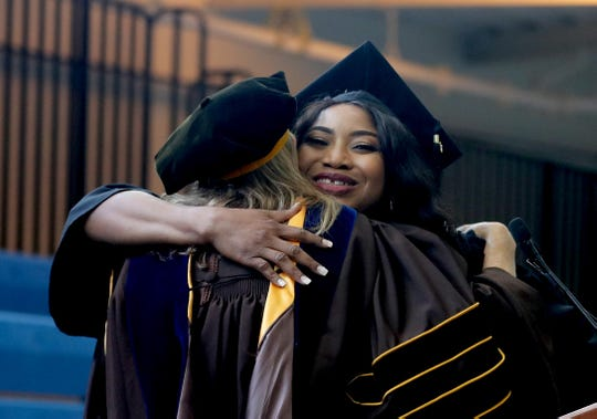 Jamila Zanfara hugs Deborah Hunt, Dean of the School of Nursing, upon receiving her diploma at the College of New Rochelle's final graduation ceremony Aug. 20, 2019. The 115 year old college, which is closing as the summer semester comes to an end, held the graduation ceremony for students who completed their degree requirements over the summer.