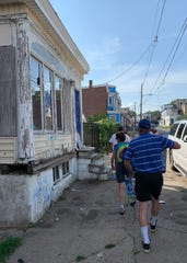 Dr. Sandra Gibney walks 22nd Street in Wilmington with her husband and other volunteers handing out naloxone, free water and other harm reduction tools.