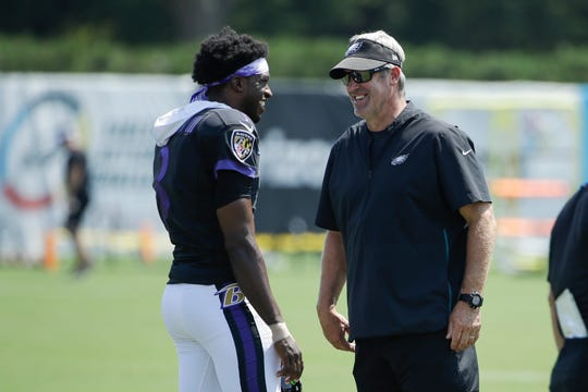 Baltimore Ravens quarterback Robert Griffin III, left, and Philadelphia Eagles head coach Doug Pederson meet during a joint NFL football practice in Philadelphia, Monday.