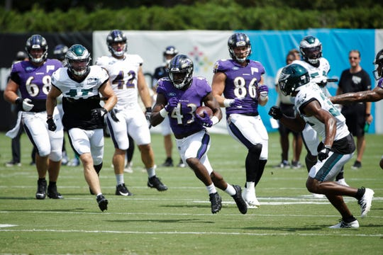 Baltimore Ravens running back Justice Hill (43) runs a play during a joint NFL football practice with the Philadelphia Eagles in Philadelphia, Tuesday.