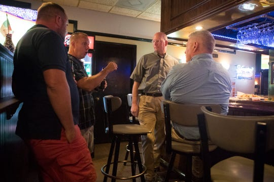 Pilots and friends John Bilbrough, from left, Michael Schmuff, Steve Early, and Rich Chadwick gather at Michael's Restaurant to reminisce and tell stories about their friend Albert Dohring, who was killed in an airplane crash Sunday Morning near I-95.