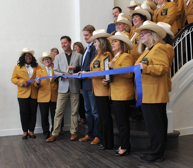 Landmark on Lamar Apartments celebrated their grand opening Tuesday morning with a ribbon-cutting ceremony held in the lobby of the remodeled historic downtown building.