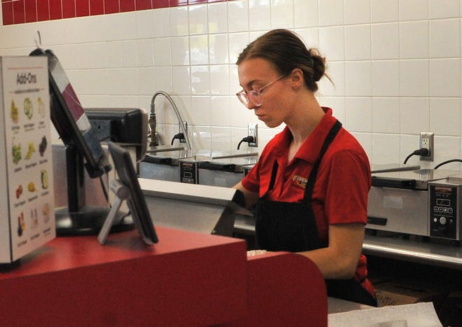 Firehouse Subs, shift leader, Hope Roehr prepares a sandwich.