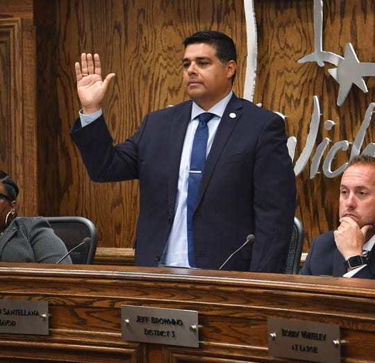 Wichita Falls Mayor Stephen Santellana is sworn in during a hearing to consider a complaint against Councilor Steve Jackson for violation of the City Council Code of Ethics Tuesday morning.