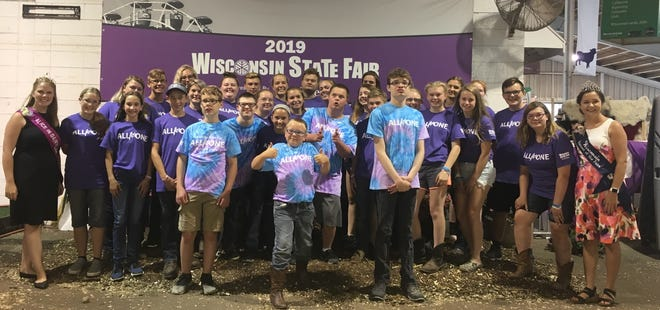Alice in Dairyland, Abigail Martin, far left, gathers with participants in the All for One show along with their mentors from the 4-H and FFA livestock project.