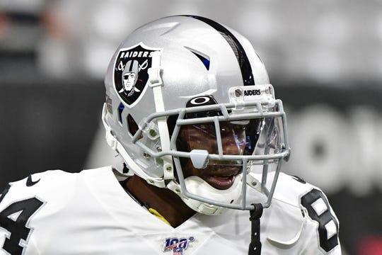 Antonio Brown wears a regulation helmet during warmups before the Raiders' preseason game against the Cardinals.