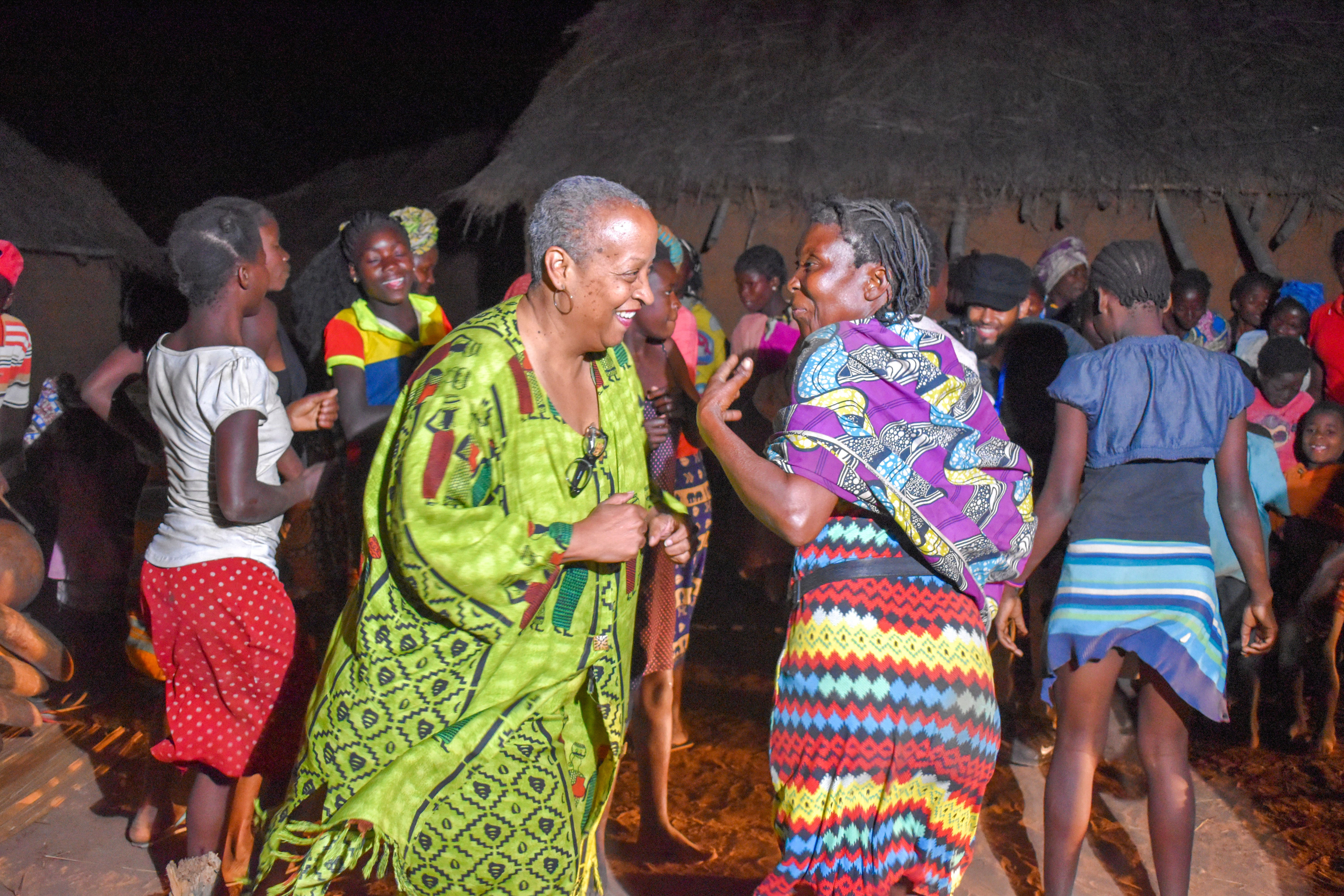 """Wanda Tucker and a village elder dance to the sounds of the marimba in Mufuma, Angola. """"It was as if she was so proud to show me something,"""" Wanda said. """"It was a connection without words."""""""