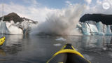 Two kayakers were hit by a massive wave after a glacier collapsed in Alaska.