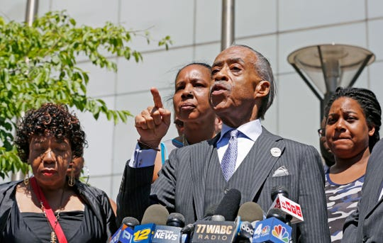 Rev. Al Sharpton gestures as he speaks to the media alongside members of Eric Garner's family after meeting with Department of Justice officials on June 21, 2017, in New York.