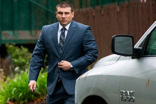 New York City police officer Daniel Pantaleo leaves his house on May 13, 2019, in Staten Island, N.Y. A long-delayed disciplinary trial began that day for Pantaleo, accused of using a banned chokehold in the July 2014 death of Eric Garner.