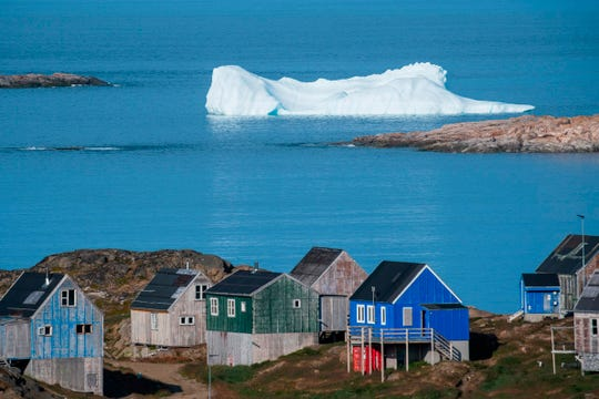 Icebergs float behind Kulusuk in Greenland on Aug. 16, 2019.