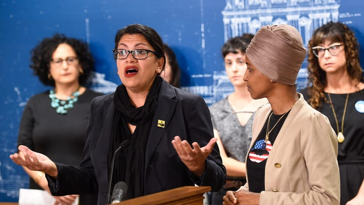 Democratic representative from Michigan Rashida Tlaib speaks during a news conference as Democratic representative from Minnesota Ilhan Omar looks on at the Minnesota state capitol in St. Paul, Minnesota, on Aug. 19, 2019.