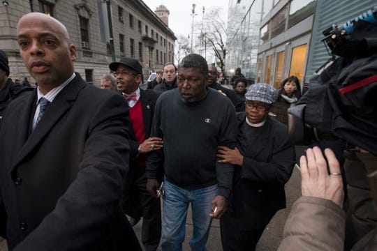 Benjamin Carr, stepfather of Eric Garner, leaves the district attorney's office after a grand jury's decision not to indict a New York police officer involved Garner's death, Dec. 3, 2014.