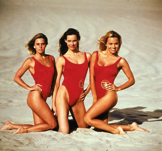"""Pamela Anderson, far right, with her """"Baywatch"""" co-stars Nicole Eggert, far left, and Alexandra Paul in 1992."""
