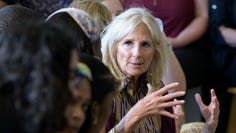 Jill Biden talks to the Youth Empowerment Project that targets at risk youth and young people as her husband Democratic presidential candidate former Vice President Joe Biden tours the YEP facilities in New Orleans, Tuesday, July 23, 2019. (AP Photo/Matthew Hinton)