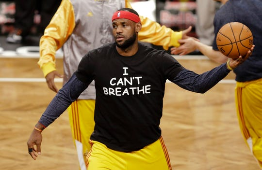 LeBron James wears a T-shirt reading