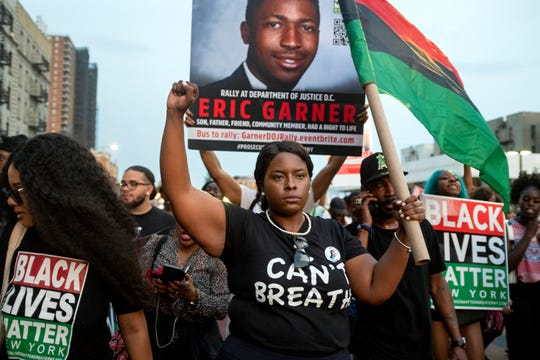 Activists with Black Lives Matter protest in the Harlem neighborhood of New York on July 16, 2019, in the wake of a decision by federal prosecutors who declined to bring civil rights charges against New York City police Officer Daniel Pantaleo.