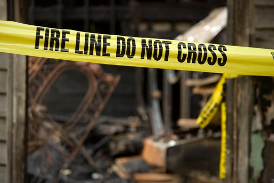 A Meals on Wheels driver saved a woman from a burning house.
