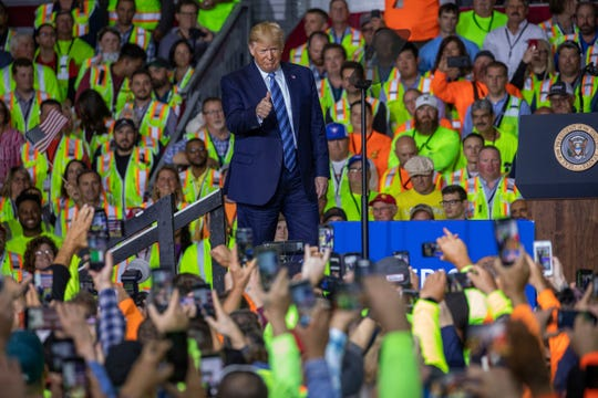 President Donald Trump walks on stage before speaking to a crowd of construction workers before touring Royal Dutch Shell's petrochemical cracker plant on Aug. 13, 2019 in Monaca, Pa.