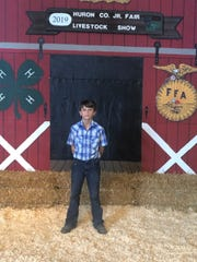 Western Reserve Schools seventh grader Diesel Pippert raised $15,000 by auctioning off a hog at the Huron County (Ohio) Fair