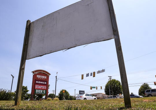 An old sign in the Beltline Plaza in a patch of undeveloped land at the intersection of Fritz Drive and Clemson Boulevard in Anderson Wednesday. The new location for a Chick-fil-A is planned for the site, replacing the current one on Clemson Boulevard and Civic Center Boulevard.