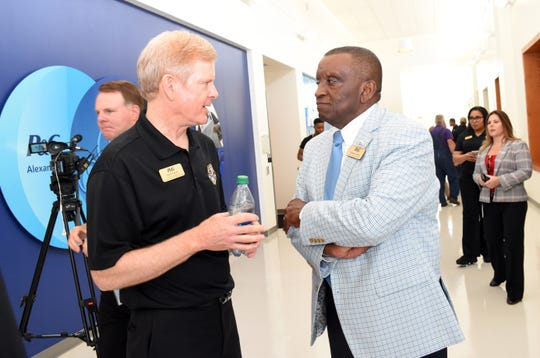David Taylor (left), chairman, president and CEO of Procter & Gamble talks with Pineville mayor Clarence Fields at  celebration held Wednesday, Aug. 21, 2019 at the Procter & Gamble plant in Pineville. The plant is celebrating 50 years of operation in Central Louisiana.