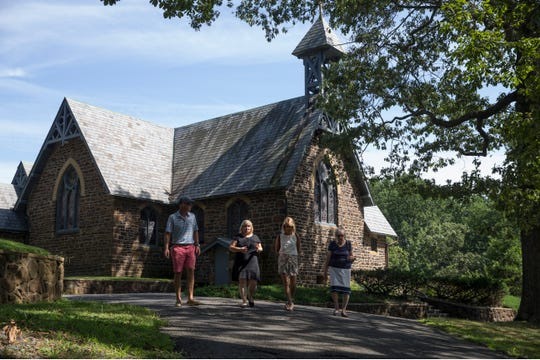 The All Saint's Memorial Church in the Highlands of Navesink was founded in 1864. The church is in need of various repairs and is seeking help with the costs involved. Landmark Trust members Jay and Becky Cosgrove, left and third from left, walk with Rev. Debbie Cook, second from left, and Marie Hess Russo, vice chairperson of the Landmark Trust.