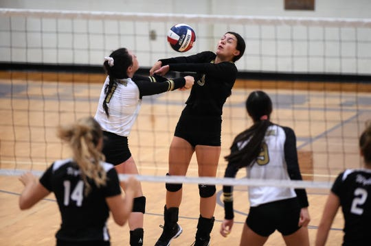 Abilene High's Madi Sipe (1) and Maddie Perez (3) both go for the ball against Wylie at Bulldog Gym on Tuesday, Aug. 20, 2019. The Lady Bulldogs won 25-20, 25-18. 25-10.