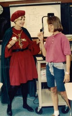 In 1492 ... 1992, actually ... Karen Turner, left, dressed as Christopher Columbus while teaching at Lincoln Middle School. Eighth-grader Andrea Gilbreth tastes sea biscuits that would've been a staple on the journey across the sea.