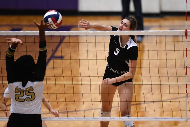 Wylie outside hitter Lilly Kate Doby spikes the ball over the net during the 3-0 win against Abilene High at Bulldog Gym on Tuesday, Aug. 20, 2019. Doby had nine kills as the Lady Bulldogs won 25-18, 25-20, 25-10 in nondistrict play.